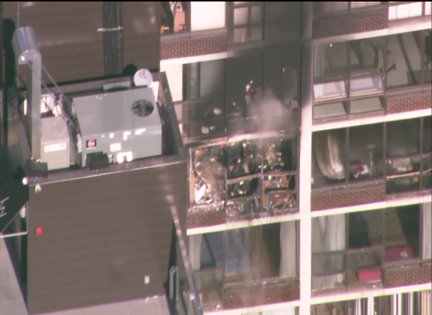 2-11 alarm fire engulfs North Side high rise