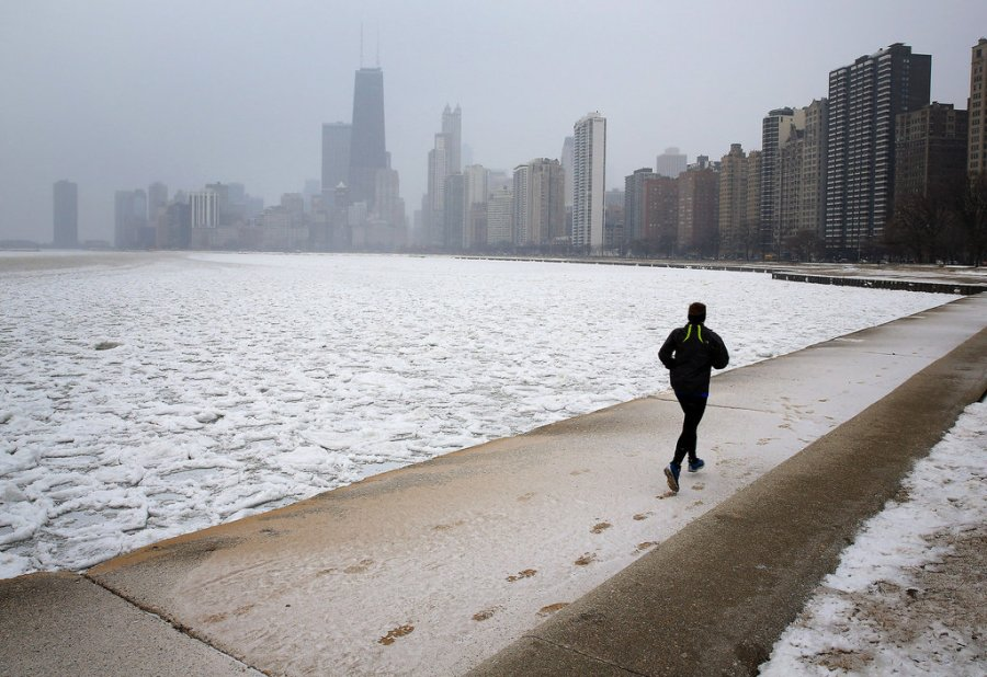 [Pin It] A jogger leaves tracks in the snow along the lakefront. — Heather Charles, Chicago Tribune, March 5, 2013