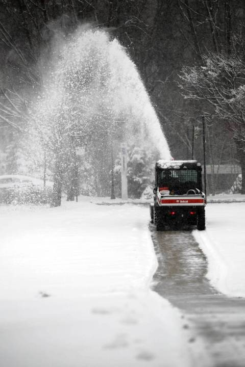 A snow thrower clears a path on the Midway Plaisance in Chicago. — Terrence Antonio James, Chicago Tribune, March 5, 2013