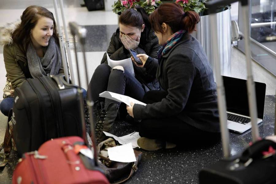 CT OHareLoyola University students Samantha Shaffer, 19, left, Yelena Svetlichnaya, 20, center, and Tala Said, 19, react to a dropped customer service call as they try to reschedule flights to Toronto after their flights were canceled at O'Hare International Airport. — Michael Tercha, Chicago Tribune, March 5, 2013Storm04.JPG