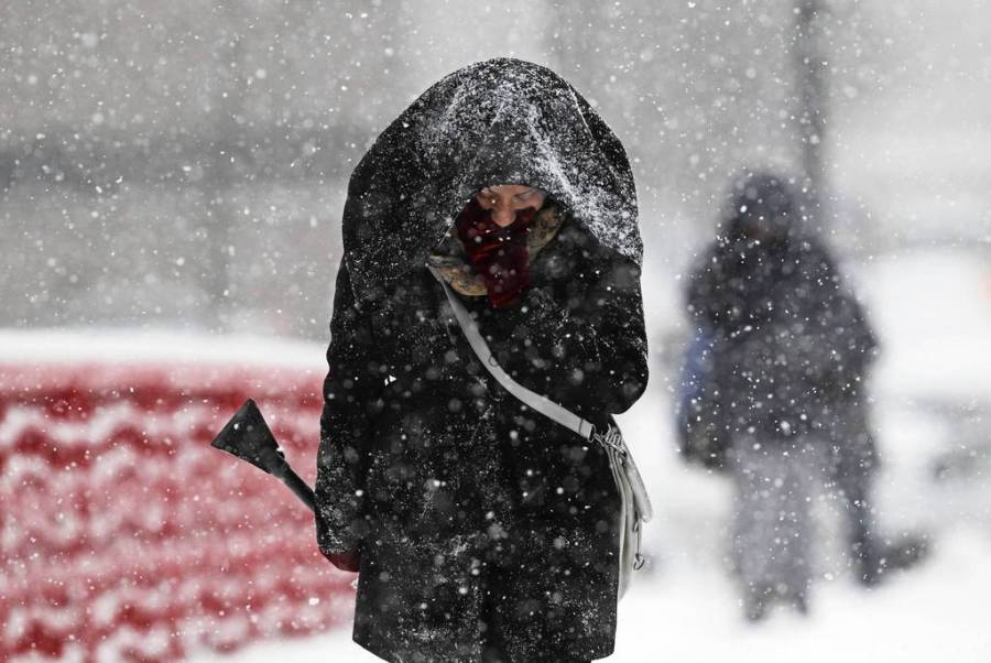 Doretha Hill walks eastbound on Washington Boulevard back to her office east of Halsted Street after locking her keys in the car. She got locked out when she stepped out to brush snow from her vehicle. — Nuccio DiNuzzo, Chicago Tribune, March 5, 2013