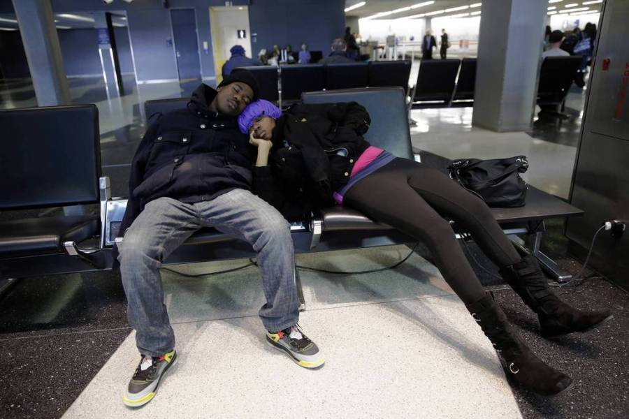 Diandre Hines and Shauntae McKnight both of Chicago, sleep at O'Hare International Airport — Michael Tercha, Chicago Tribune, March 5, 2013