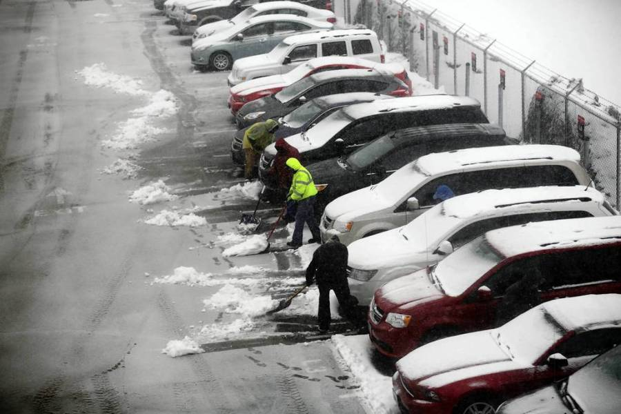Crews remove snow from cars in the Avis rental car lot at O'Hare International Airport. — Michael Tercha, Chicago Tribune, March 5, 2013