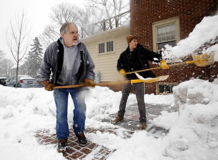 [Pin It] John Rygiewicz, left, North Central College head groundskeeper, and part-time helper Tommy Lusk, 17, shovel the walkways around school buildings in Naperville. Tommy is a high school senior who has the day off. The snowstorm builds with a constant snowfall covering the sidewalks and roads. — Chuck Berman, Chicago Tribune, March 5, 2013