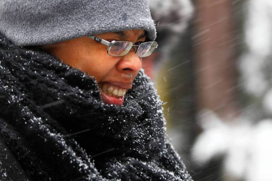 [Pin It] Snow pelts the face of a woman walking in downtown Chicago. — Anthony Souffle, Chicago Tribune, March 5, 2013
