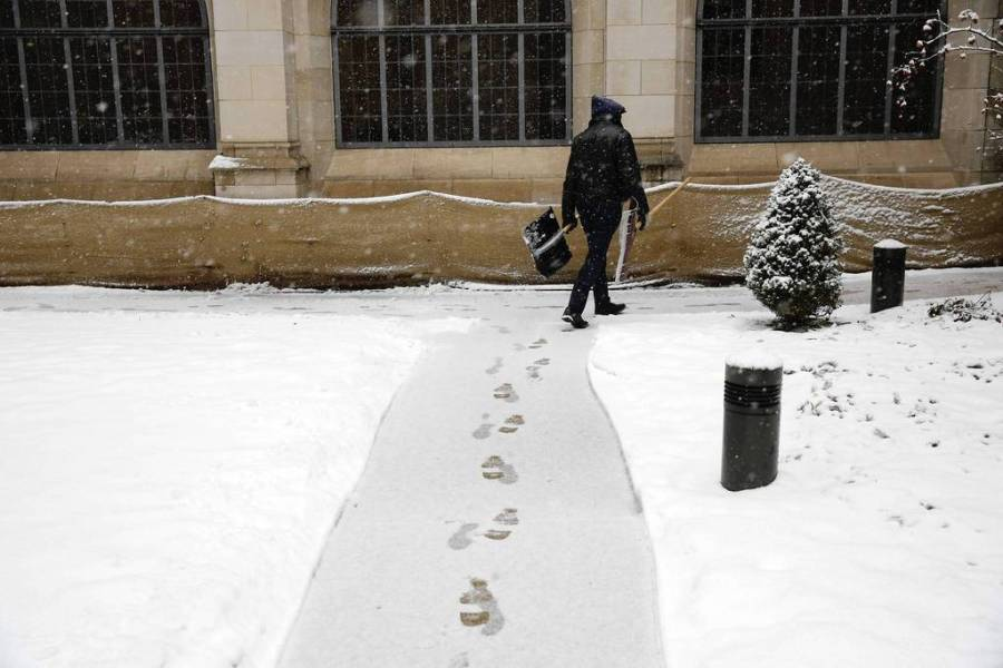 A custodian at Fourth Presbyterian Church on Chestnut Street at North Michigan Avenue finishes a round of sidewalk shoveling. — Chris Walker, Chicago Tribune, March 5, 2013