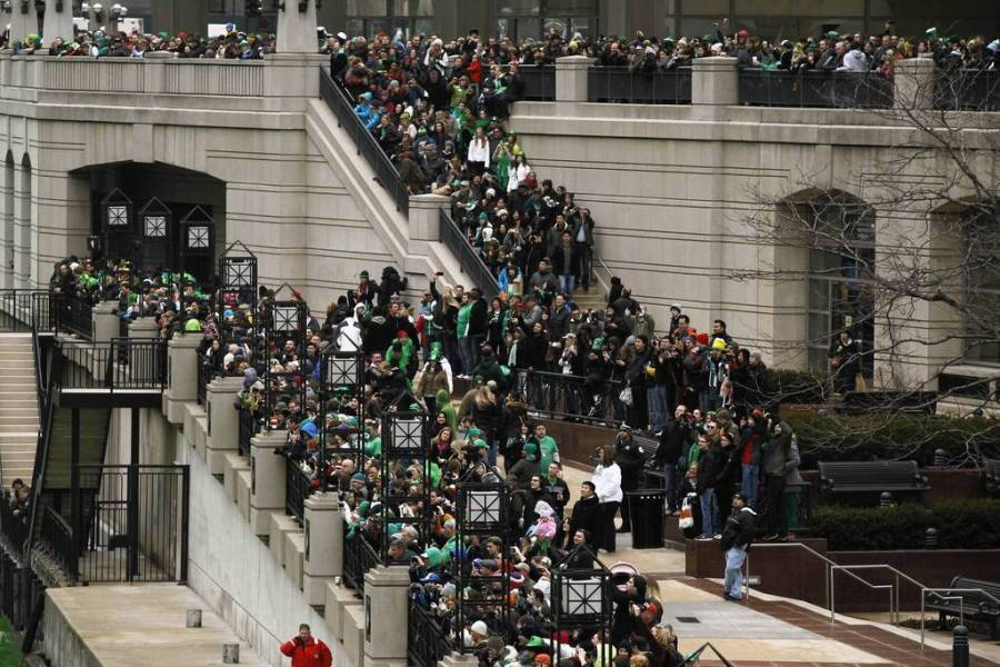 """Crowds flocked to the riverfront next to Michigan Avenue for the annual dyeing of the Chicago River for St. Patrick's Day. Thousands """"ooohed"""" in the frigid temperatures as a boat left a trail of lime green dye in the water in downtown Chicago. — Brian Cassella, Chicago Tribune, March 16, 2013"""