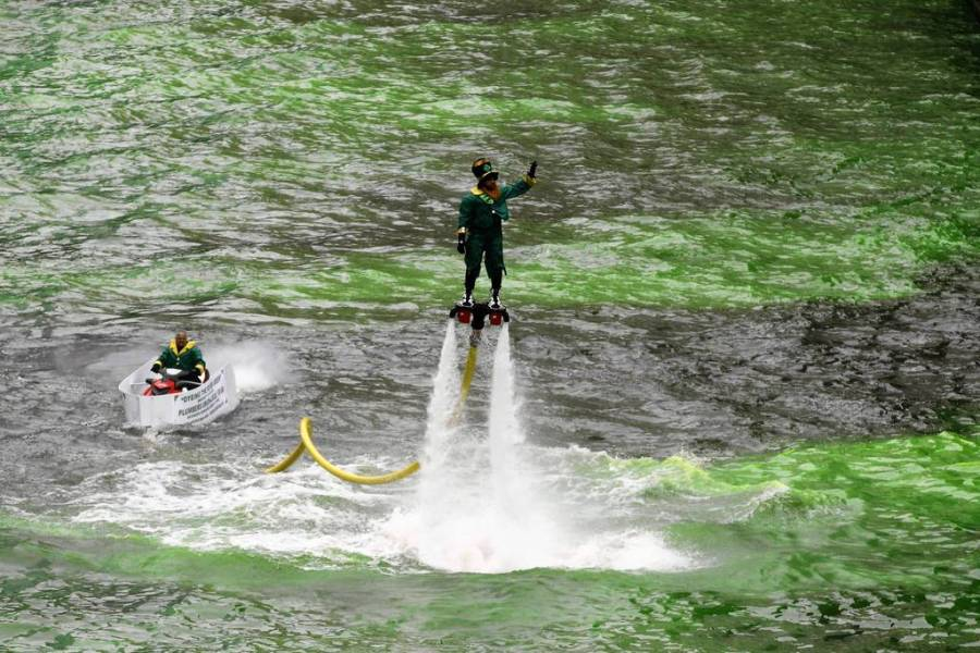 """The dyeing of the Chicago River began at about 10 a.m. as thousands """"ooohed"""" in the frigid temperatures as a boat left a trail of lime green dye in the water in downtown Chicago. — Brian Cassella, Chicago Tribune, March 12, 2013"""