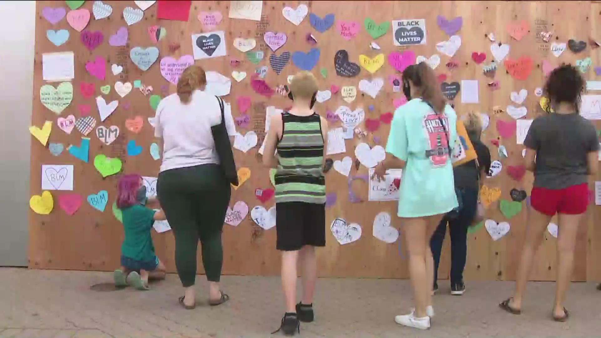neighbors hang hearts in Naperville