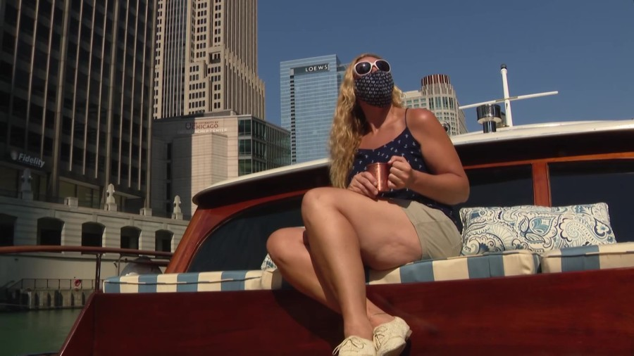 woman with a mask on a boat on the Chicago River