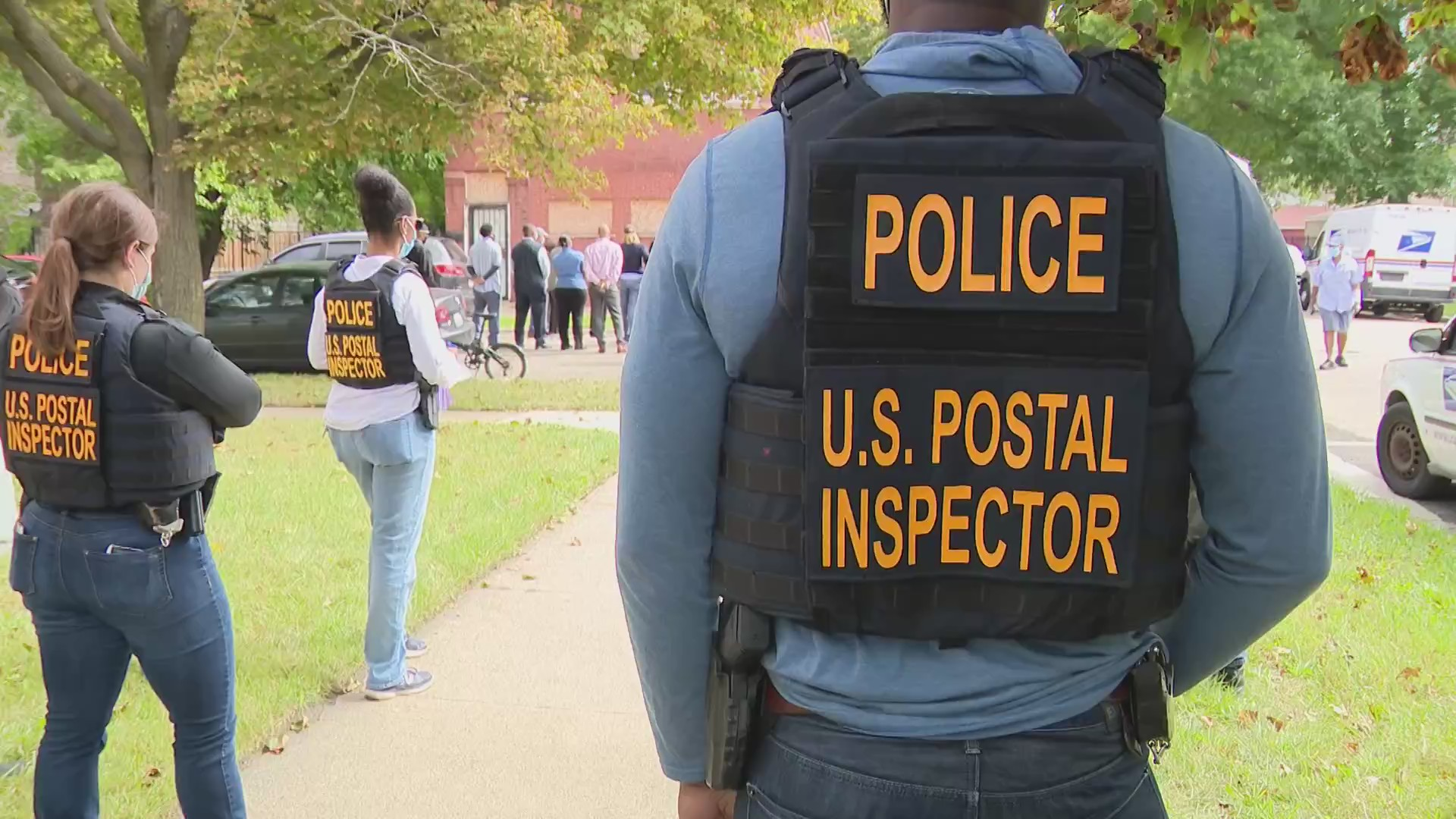 U.S. Postal Inspector is shown from the back